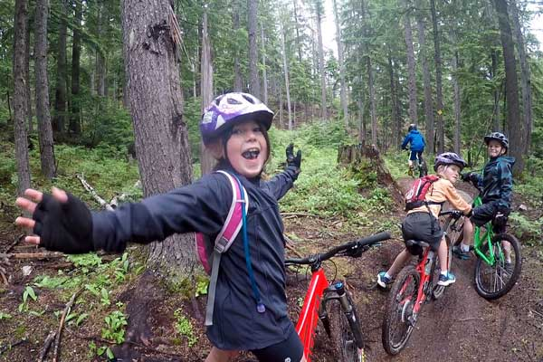 Kids Camp group riding one of the singletrack mountain bike trails at MacPherson